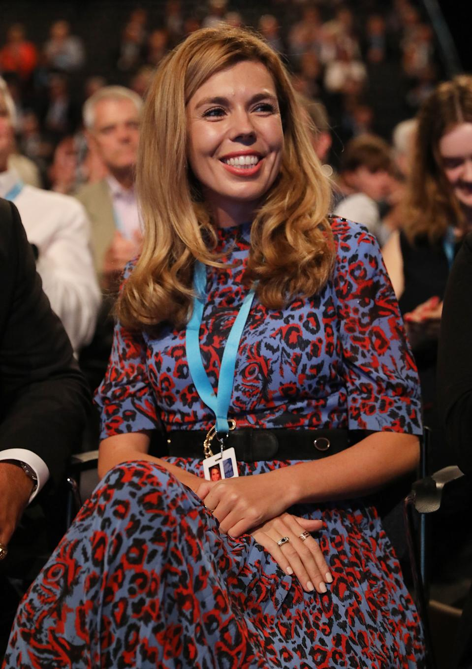 Carrie Symonds opted for a colourful animal print midi dress from Whistles on the second day of the Conservative Party Conference in Manchester [Photo: PA]