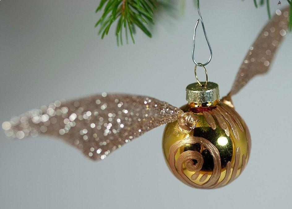 """<p>Simply use dollar store gold ornaments to craft these Quidditch essentials, then add some craft wire to shape your snitch wings. </p><p><strong>Get the tutorial at <a href=""""http://tinyapartmentcrafts.blogspot.com/2010/12/golden-snitch-ornament-tutorial.html"""" rel=""""nofollow noopener"""" target=""""_blank"""" data-ylk=""""slk:Tiny Apartment Crafts"""" class=""""link rapid-noclick-resp"""">Tiny Apartment Crafts</a>.</strong> </p><p><a class=""""link rapid-noclick-resp"""" href=""""https://www.amazon.com/Sulyn-SUL51122-oz-Glitter-Jar/dp/B009EA1BQO/?tag=syn-yahoo-20&ascsubtag=%5Bartid%7C10050.g.2764%5Bsrc%7Cyahoo-us"""" rel=""""nofollow noopener"""" target=""""_blank"""" data-ylk=""""slk:SHOP GOLD GLITTER"""">SHOP GOLD GLITTER</a></p>"""