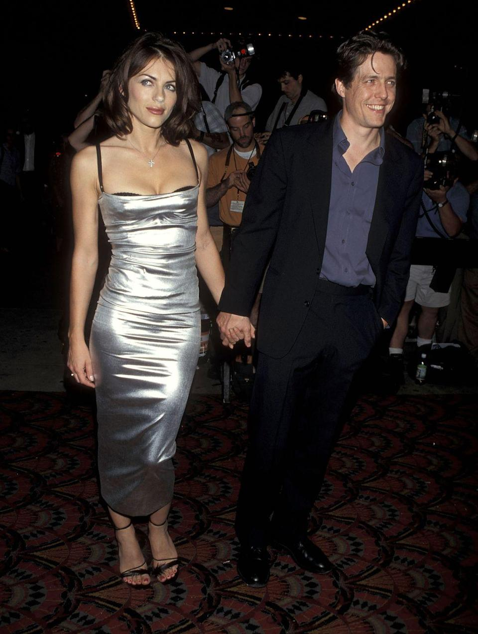 <p>Elizabeth played Sandra in <em>Permanent Midnight </em>in the late '90s, which provided an opportunity for Hugh to support <em>her </em>on the red carpet. How amazing is her futuristic dress btw?</p>