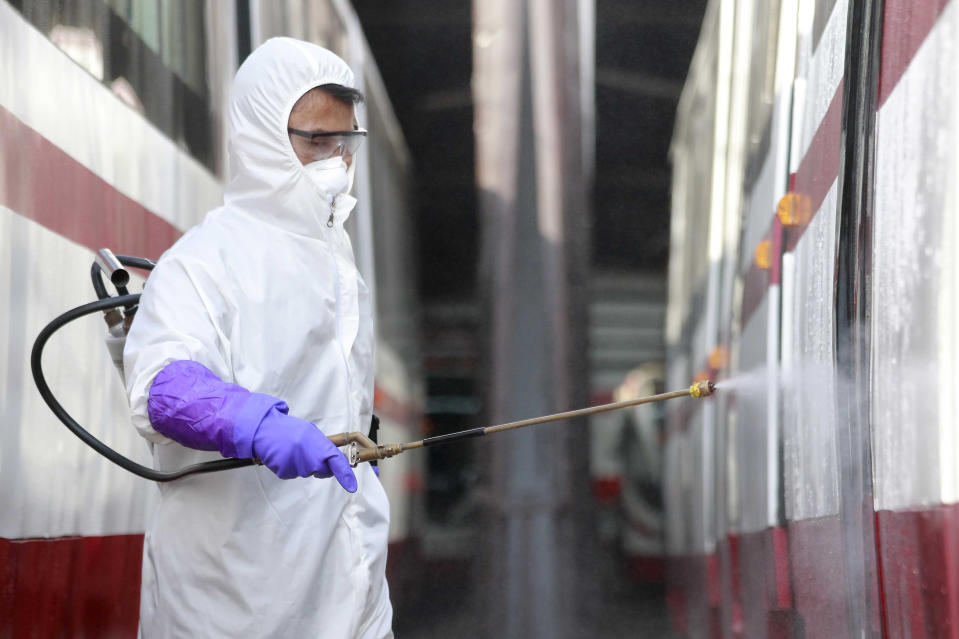 A member from an emergency anti-epidemic headquarters in Mangyongdae District disinfects a tramcar of Songsan Tram Station to prevent new coronavirus infection in Pyongyang, North Korea Wednesday, Feb. 26, 2020. Uncertainly remained over how best to stem the spread of the illness. (AP Photo/Cha Song Ho)