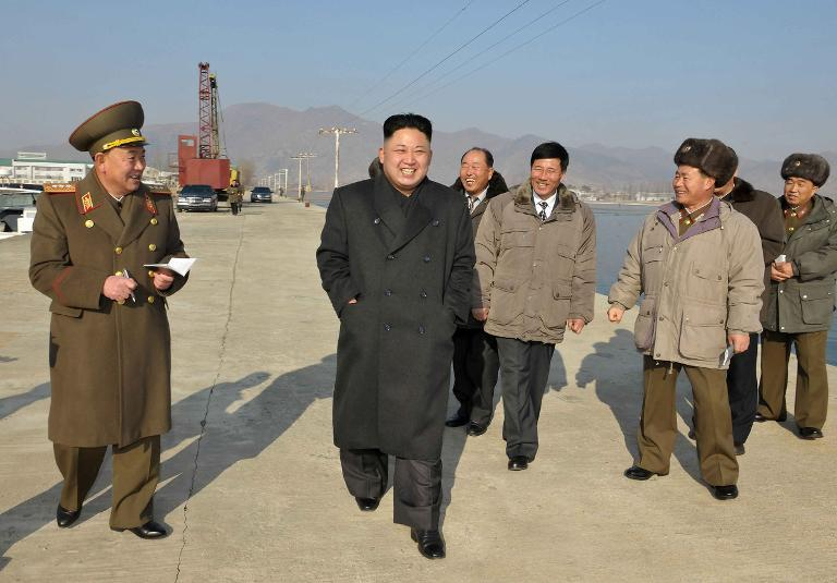 North Korean leader Kim Jong-Un (C) inspects an aquatic products refrigerating facility at an undisclosed location on January 7