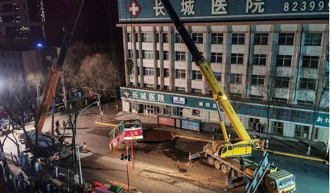 An investigation into the road collapse is under way. Photo: Weibo