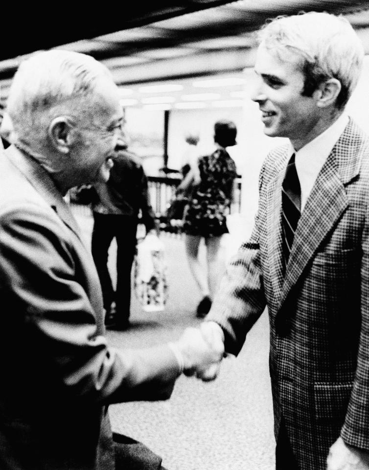 In this March 31, 1973 photo, Adm. John S. McCain Jr., left, and his son, Lt. Cmdr. John S. McCain III meet for the first time in Jacksonville, Fla. As the last U.S. combat troops left Vietnam 40 years ago, angry protesters still awaited them at home. North Vietnamese soldiers took heart from their foes' departure, and South Vietnamese who had helped the Americans feared for the future. While the fall of Saigon two years later — with its indelible images of frantic helicopter evacuations — is remembered as the final day of the Vietnam War, Friday marks an anniversary that holds greater meaning for many who fought, protested or otherwise lived it. (AP Photo)