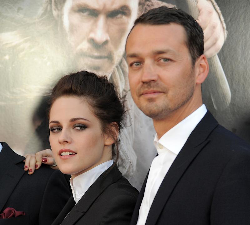 """FILE - This May 29, 2012 file photo shows actress Kristen Stewart and director Rupert Sanders attending the """"Snow White and the Huntsman"""" screening in Los Angeles. Stewart and director Rupert Sanders apologized publicly to their loved ones following reports of infidelity. The 22-year-old actress and the 41-year-old filmmaker issued separate apologies to People magazine Wednesday, July 25, saying they regret the hurt they have caused. Stewart has been in a relationship for several years with her """"Twilight"""" co-star Robert Pattinson. Sanders is married and has two children. (Photo by Jordan Strauss/Invision/AP)"""