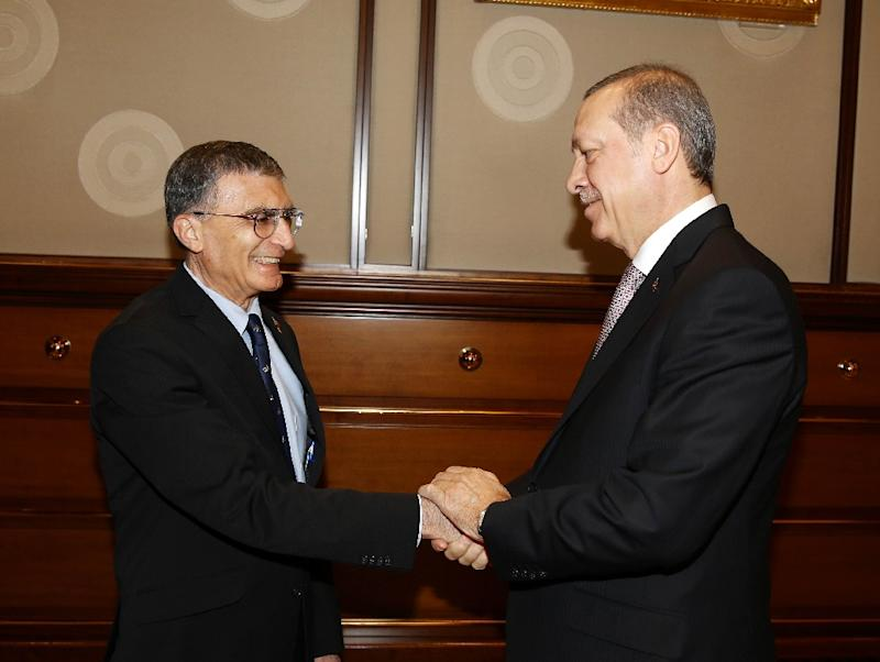 Co-winner of the 2015 Nobel Prize in chemistry, Turkish-American professor Aziz Sancar (L) meets with Turkish president Recep Tayyip Erdogan at the presidential palace in Ankara, on December 15, 2015
