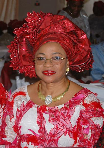 In this photo taken,Saturday Oct. 5, 2013, Folorunsho Alakija, attends a function in Lagos, Nigeria. Ventures Africa a pan-African magazine says Africa has many more billionaires than previously reported, 55 of them worth $143.88 billion. The magazine's survey surprised by identifying oil tycoon Folorunsho Alakija as the richest black woman in the world, saying that she is worth $7.3 billion. Forbes magazine in its respected list had estimated Alakija's fortune at $600 million and Oprah Winfrey's worth at $2.9 billion. (AP Photo)