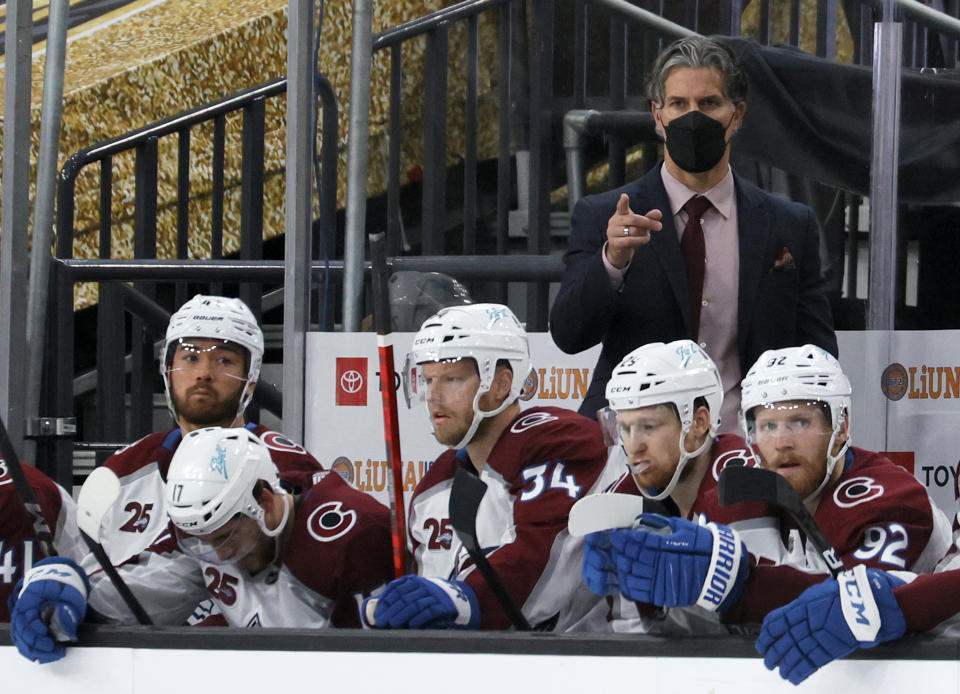 LAS VEGAS, NEVADA - JUNE 06:  Head coach Jared Bednar of the Colorado Avalanche handles bench duties behind Kiefer Sherwood #44, Tyson Jost #17, Carl Soderberg #34, Nathan MacKinnon #29 and Gabriel Landeskog #92 in the third period in Game Four of the Second Round of the 2021 Stanley Cup Playoffs against the Vegas Golden Knights at T-Mobile Arena on June 6, 2021 in Las Vegas, Nevada. The Golden Knights defeated the Avalanche 5-1.  (Photo by Ethan Miller/Getty Images)