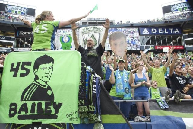 Seattle Sounders fans cheer for Seattle Sounders player Xander Bailey following a friendly soccer match against Tottenham Hotspur in Seattle, Saturday, July 19, 2014. The match ended in a 3-3 draw. Bailey was signed to the Sounders for the match as part of the Make-A-Wish program. (AP Photo/Stephen Brashear)
