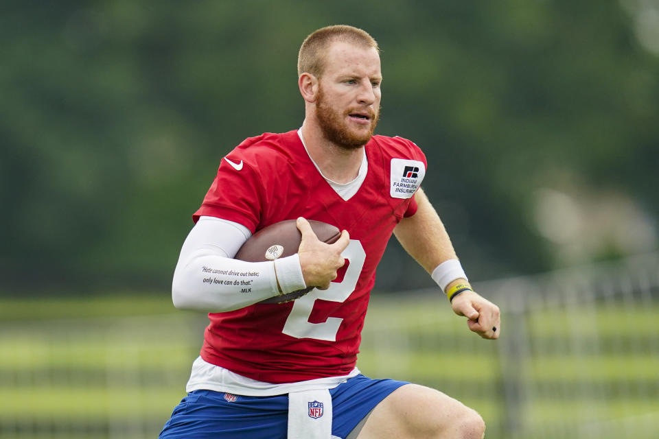 Indianapolis Colts quarterback Carson Wentz runs a drill during practice at the NFL team's football training camp in Westfield, Ind., Wednesday, July 28, 2021. (AP Photo/Michael Conroy)