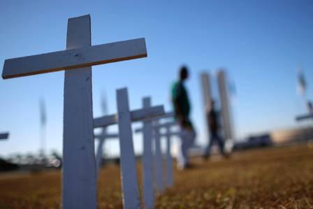 88813816_Crosses symbolising the ones who died from the coronavirus disease COVID-19 stand in front (1).jpg