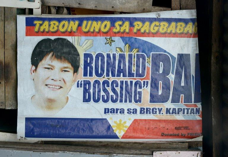 A campaign poster showing an image of Ronaldo Bae hangs from a shanty house in Kawit, near Manila, on January 4, 2013