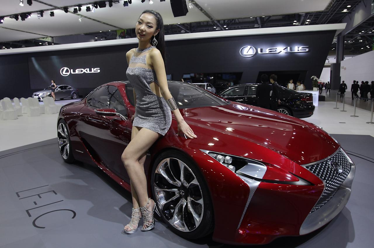 GOYANG, SOUTH KOREA - MARCH 28:  A Model poses next to a Lexus LF-LC Hybrid Sport Coupe Concept at the Seoul Motor Show 2013 on March 28, 2013 in Goyang, South Korea. The Seoul Motor Show 2013 will be held in March 29-April 7, featuring state-of-the-art technologies and concept cars from global automakers. The show is its ninth since the first one was held in 1995. About 384 companies from 14 countries, including auto parts manufacturers and tire makers, will set up booths to showcase trends in their respective industries, and to promote their latest products during the show.  (Photo by Chung Sung-Jun/Getty Images)