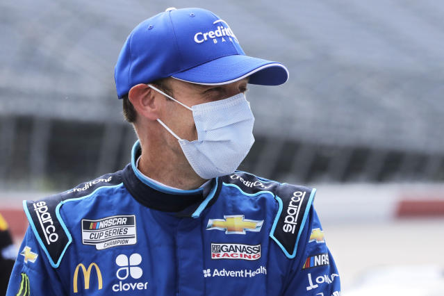 Matt Kenseth waits for the start of the NASCAR Cup Series auto race Sunday, May 17, 2020, in Darlington, S.C. (AP Photo/Brynn Anderson)