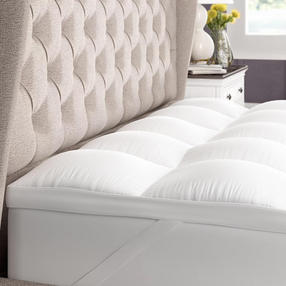 "<br><br><strong>Alwyn Home</strong> Gerstner Thick Hypoallergenic 2"" Mattress Topper, $, available at <a href=""https://go.skimresources.com/?id=30283X879131&url=https%3A%2F%2Fwww.wayfair.com%2Fbed-bath%2Fpdp%2Falwyn-home-gerstner-thick-hypoallergenic-2-down-alternative-bed-mattress-topper-hshd1215.html"" rel=""nofollow noopener"" target=""_blank"" data-ylk=""slk:Wayfair"" class=""link rapid-noclick-resp"">Wayfair</a>"