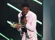 """Lil Nas X accepts the award for video of the year for """"Montero (Call Me By Your Name)"""" at the MTV Video Music Awards at Barclays Center on Sunday, Sept. 12, 2021, in New York. (Photo by Charles Sykes/Invision/AP)"""