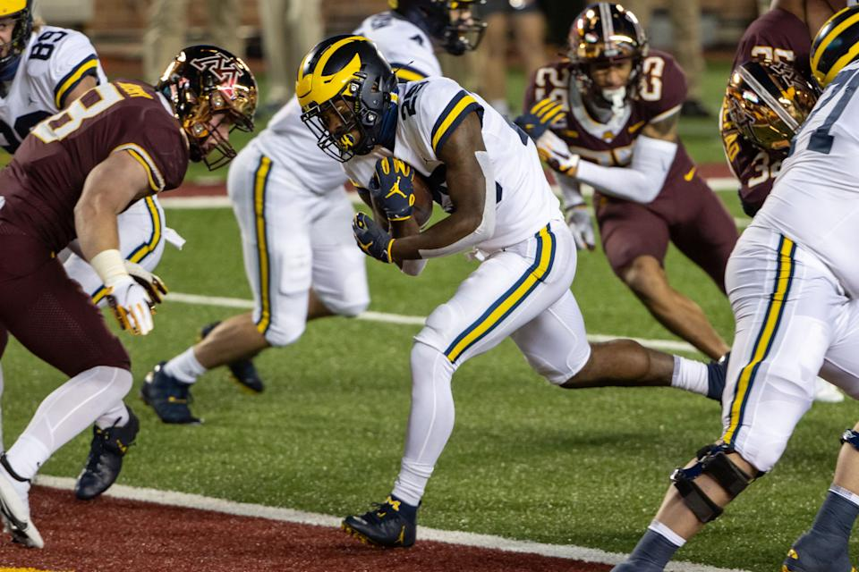 Michigan Wolverines running back Hassan Haskins rushes for a touchdown in the first half against Minnesota at TCF Bank Stadium, Oct. 24, 2020.