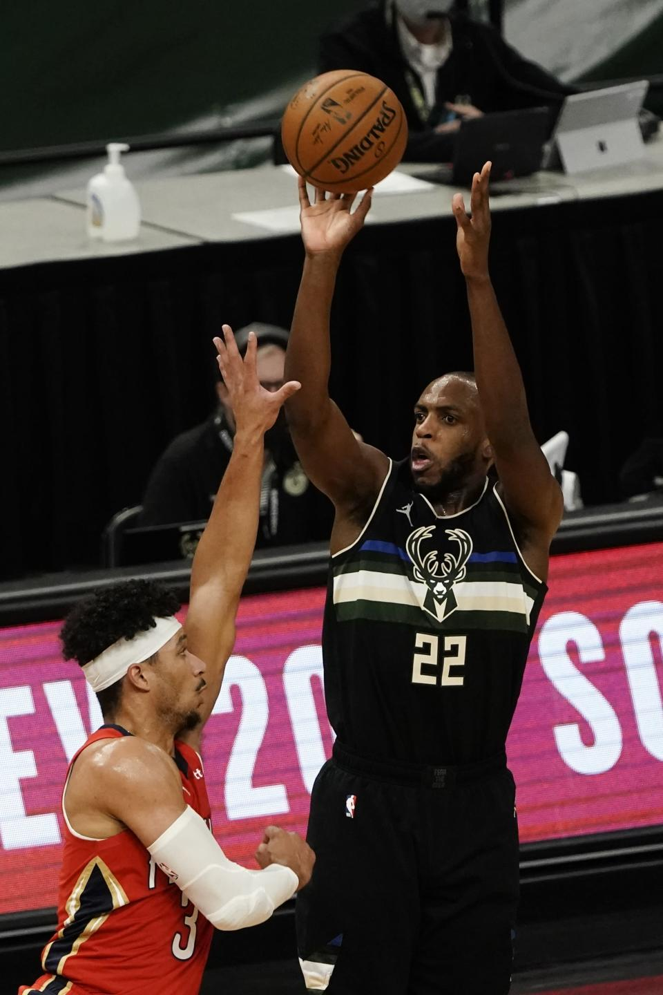 Milwaukee Bucks' Khris Middleton shoots over New Orleans Pelicans' Josh Hart during the second half of an NBA basketball game Thursday, Feb. 25, 2021, in Milwaukee. (AP Photo/Morry Gash)