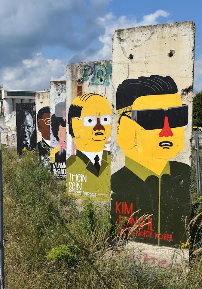 <p>Parts of the Berlin wall have been painted with the heads of politicians, like Kim Jong-il ®, in Teltow, Germany on August 8, 2016. (Bernd Settnik/EPA)</p>
