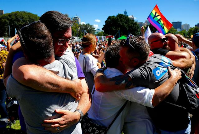 <p>People celebrate after it was announced the majority of Australians support same-sex marriage in a national survey, paving the way for legislation to make the country the 26th nation to formalize the unions by the end of the year, at a rally in central Sydney, Australia, Nov. 15, 2017. (Photo: David Gray/Reuters) </p>