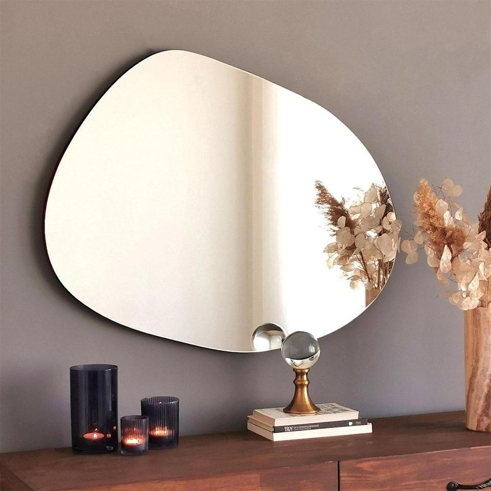 <p>This <span>Cloud Mirror</span> ($318) will look cute no matter where you put it.</p>