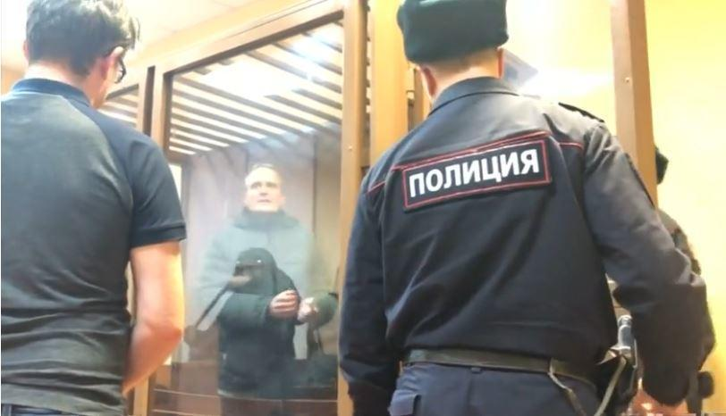 A mobile phone video from the Reuters news agency shows Dennis Christensen, a Danish national who has been imprisoned, talking to a journalist after a trial in Oryol, Russia, where he is accused of