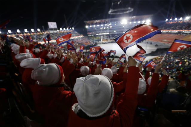 <p>Members of the North Korean delegation wave flags before the opening ceremony of the 2018 Winter Olympics in Pyeongchang, South Korea, Friday, Feb. 9, 2018. (AP Photo/Natacha Pisarenko) </p>