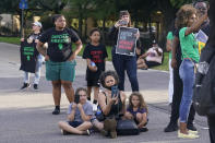 Demonstrators block an access ramp to I-110 after a march from the state Capitol to the governor's mansion, Thursday, May 27, 2021, in Baton Rouge, La., protesting the death of Ronald Greene, who died in the custody of Louisiana State Police in 2019,. (AP Photo/Gerald Herbert)