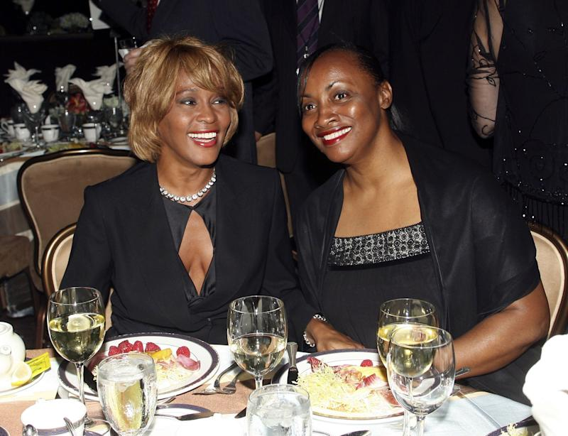BEVERLY HILLS - SEPTEMBER 12: (L-R) Recording artist Whitney Houston and an unidentified guest attend the 15th Annual Ella Awards at the Beverly Hilton Hotel on September12, 2006 in Beverly Hills, California. (Photo by Frederick M. Brown/GettyImages)
