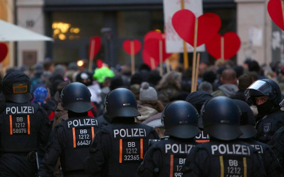 Police on a street as people march during a demonstration against German coronavirus restrictions, in Leipzig - OMER MESSINGER/EPA-EFE/Shutterstock