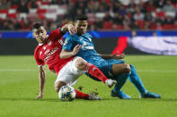 Zenit's Douglas Santos, right, battles for the ball with Benfica's Andre Almeida during the Champions League group G soccer match between Benfica and Zenit St. Petersburg at the Luz stadium in Lisbon, Tuesday, Dec. 10, 2019. (AP Photo/Armando Franca)