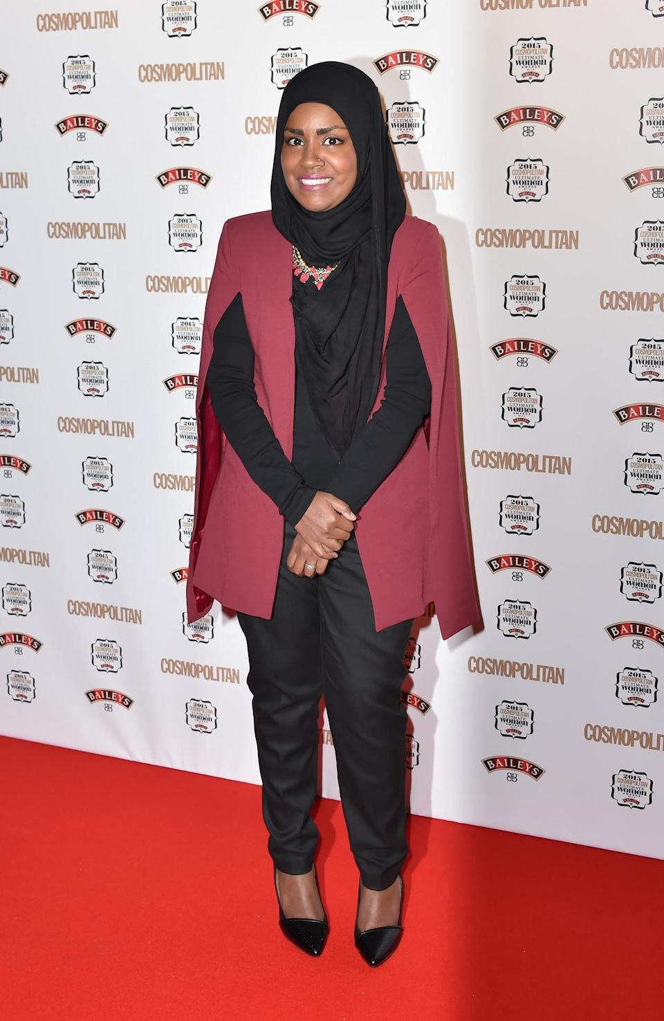 """This year's """"Great British Bake Off"""" winner Nadiya Hussain looked chic in black trousers and a maroon cape. [Photo: Getty]"""
