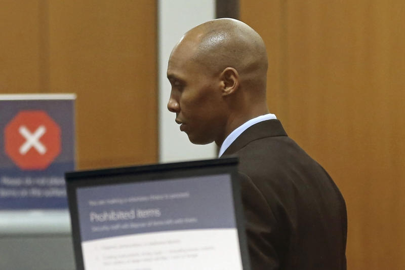 CORRECTS TO APRIL 25, 2019-Mohamed Noor, the former Minneapolis police officer waits to go through security at the Hennepin County Government Center Thursday, April 25, 2019 in Minneapolis in the fourth week of his trial. Noor is charged with second-degree intentional murder, third-degree murder and second-degree manslaughter in the July 15, 2017, shooting death of Justine Ruszczyk Damond, a 40-year-old life coach and Australian-American who had called 911 to report a possible sexual assault behind her home. (AP Photo/Jim Mone)
