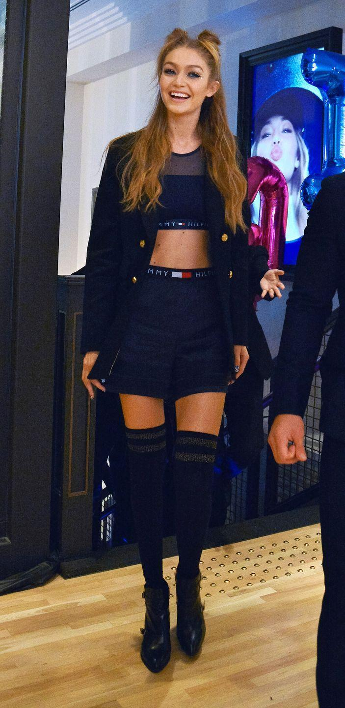 <p>In a mesh sports bra, high-waisted shorts, thigh-high socks, leather ankle boots and a navy peacoat, all by Tommy Hilfiger, in Tokyo. </p>