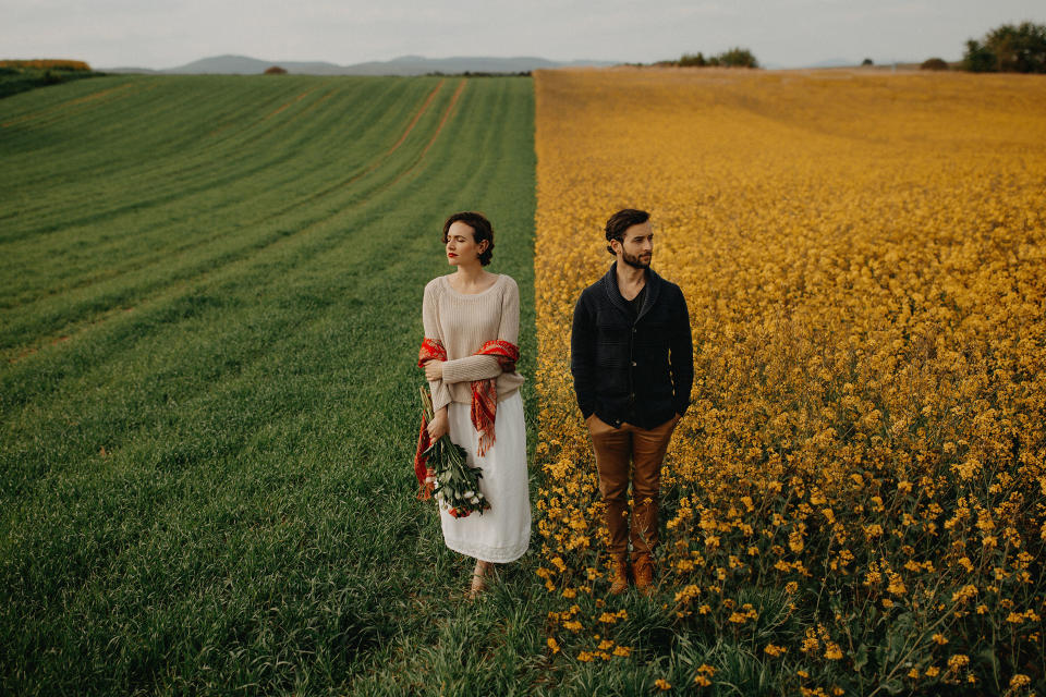 <p>In some images, newlywed couples can be seen strolling through fields in full bloom. (Photo: Junebug Weddings/Caters News) </p>