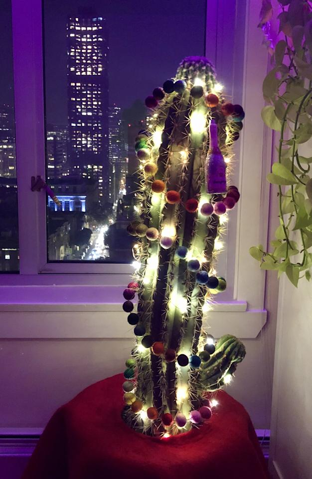 <p>Add the lights that you feel complement your cactus best. If you have colorful garland and don't want to overdo it, keep it simple with white lights. Or if you have a specific color scheme in mind, go with that. I chose these battery-operated LED twinkle lights.</p>