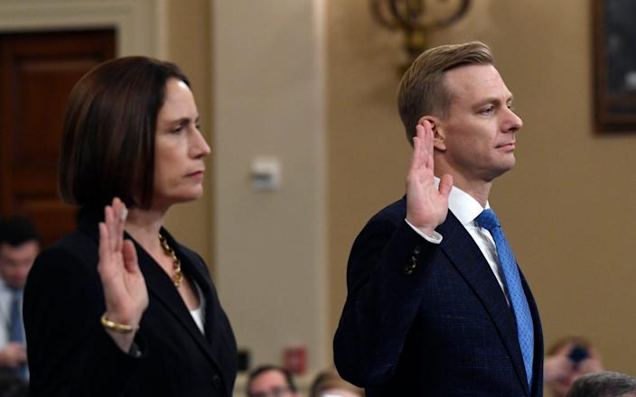 Witnesses Fiona Hill and David Holmes being sworn in at the impeachment hearings - AP