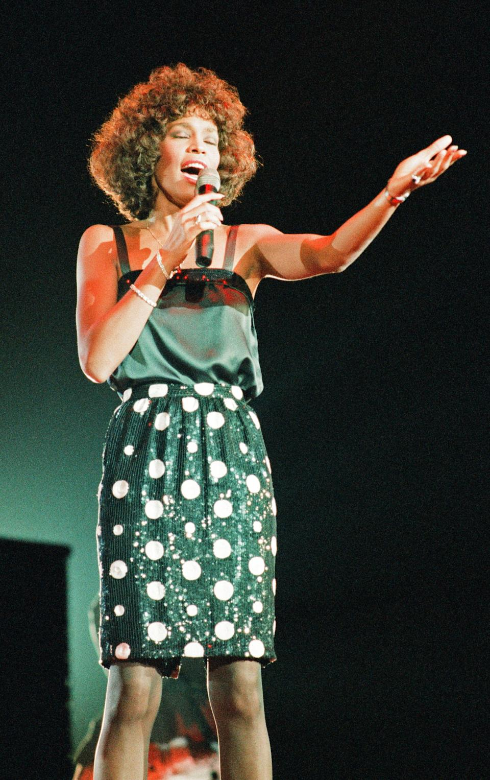Whitney Houston, seen here performing in 1987, died in 2012. (Photo: Williams/Mirrorpix/Getty Images)