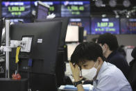 A currency trader watches monitors at the foreign exchange dealing room of the KEB Hana Bank headquarters in Seoul, South Korea, Friday, Feb. 26, 2021. Asian shares skidded Friday after rising bond yields triggered a broad sell-off on Wall Street that erased the markets gain for the week and handed the Nasdaq composite index its steepest loss since October. (AP Photo/Ahn Young-joon)