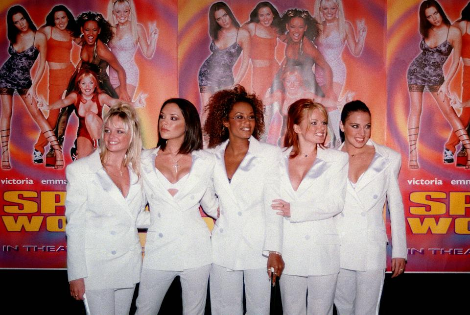 The Spice Girls, a British pop group, pose, from left: Emma Banton (Baby Spice), Victoria Adams (Posh Spice), Melanie Brown (Scary Spice), Geri Halliwell (Ginger Spice) and Melanie Chisholm (Sporty Spice) Thursday, Jan. 22, 1998, at the premiere of their movie