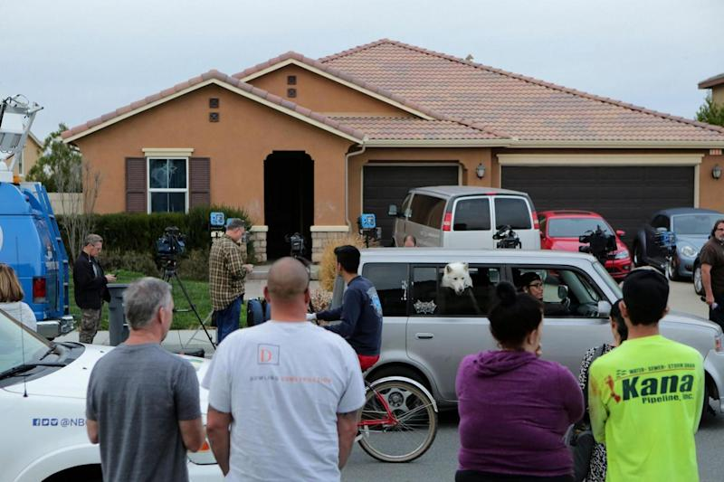 Residents gathered outside the California home after 13 children were found held captive (AFP/Getty Images)