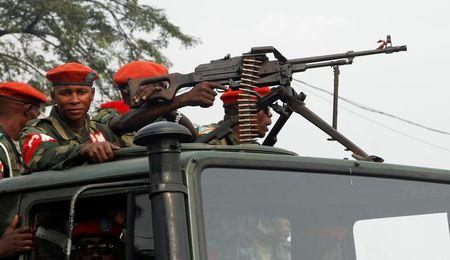 FILE PHOTO: Military police officers ride on a truck as they patrol the streets of Kinshasa