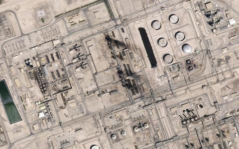 This satellite overview handout image obtained September 16, 2019 courtesy of Planet Labs Inc. shows damage to oil infrastructure from weekend drone attacks at Abqaig
