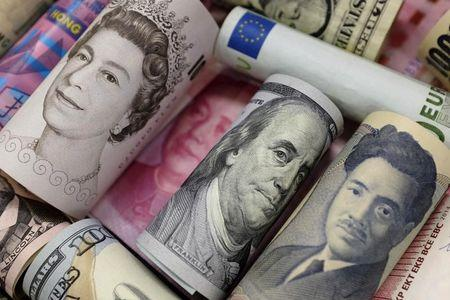 Banknotes of Euro, Hong Kong dollar, U.S. dollar, Japanese yen, GB pound and Chinese 100 yuan are seen in this picture illustration, in Beijing