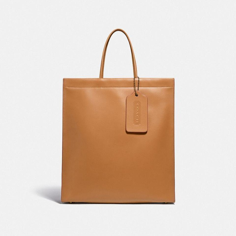 """<p><strong>Coach</strong></p><p>coach.com</p><p><strong>$650.00</strong></p><p><a href=""""https://go.redirectingat.com?id=74968X1596630&url=https%3A%2F%2Fwww.coach.com%2Fcoach-a-love-letter-to-new-york-cashin-carry-shopper-tote-36%2FC3753.html&sref=https%3A%2F%2Fwww.harpersbazaar.com%2Ffashion%2Ftrends%2Fg34109357%2Fcoach-spring-2021-collection%2F"""" rel=""""nofollow noopener"""" target=""""_blank"""" data-ylk=""""slk:Shop Now"""" class=""""link rapid-noclick-resp"""">Shop Now</a></p>"""