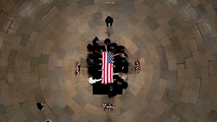 Members of the Faith and Politics Institute pause for prayers to pay their respects to John Lewis