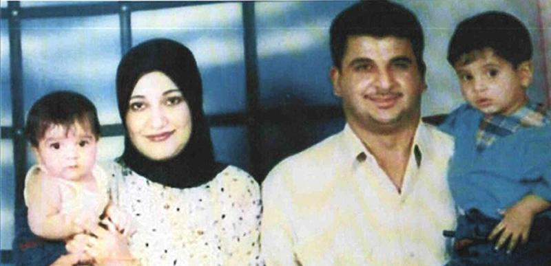 """FILE - Undated handout photo made available by the Baha Mousa Public Inquiry shows Iraqi man  Baha Mousa and family. A British doctor was stripped of his medical license Friday, Dec. 21, 2012, for misconduct and dishonesty over the death of an Iraqi man who was beaten and killed while in the custody of British troops.The latest fallout from Britain's troubled occupation of Iraq came as defense officials confirmed they have paid 14 million pounds ($23 million) to settle claims of abuse from more than 200 Iraqis. Dr. Derek Keilloh treated Baha Mousa, a hotel clerk who died at a British base after being detained in Basra in September 2003 during a sweep for insurgents. Keilloh, then a 28-year-old captain in the Queen's Lancashire Regiment, tried unsuccessfully to revive Mousa, but denied knowledge of the scale of the man's injuries. A public inquiry found that Mousa had sustained 93 injuries, including fractured ribs and a broken nose, in an """"appalling episode of serious gratuitous violence"""" by British troops. (AP Photo/Baha Mousa Inquiry, File)"""
