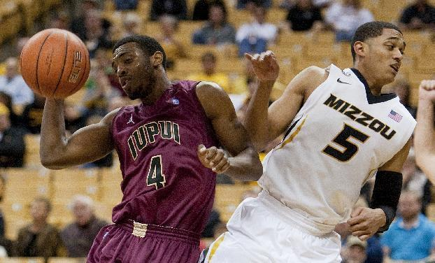 Missouri's Jordan Clarkson, right, fouls IUPUI's Ian Chiles as they vie for a rebound during the second half of an NCAA college basketball game Monday, Nov. 25, 2013, in Columbia, Mo. Missouri won 78-64. (AP Photo/L.G. Patterson)