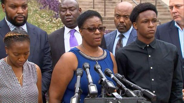 PHOTO: Allison Jean stands between her children, Allisa Charles-Findley and Brandt Jean, as she speaks at a press conference about her son who was killed by a police officer in Dallas on Monday, Sept. 10, 2018. (WFAA)