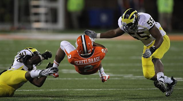 CHAMPAIGN, IL - NOVEMBER 12: Nathan Scheelhaase #2 of the Illinois Fighting Illini is upended by Thomas Gordon #30 of the Michigan Wolverines as Jibreel Black #55 closes in at Memorial Stadium on November 12, 2011 in Champaign, Illinois. Michigan defeated Illinois 31-14. (Photo by Jonathan Daniel/Getty Images)