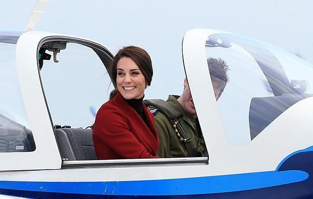 Kate beamed as she sat in the plane. Photo: Getty